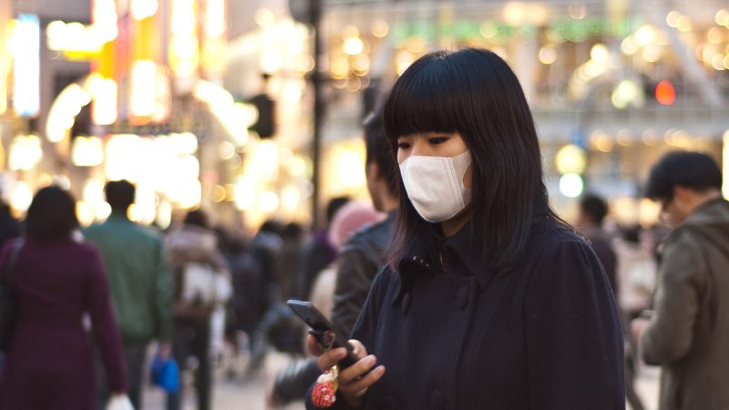 A japanese woman wearing a face mask