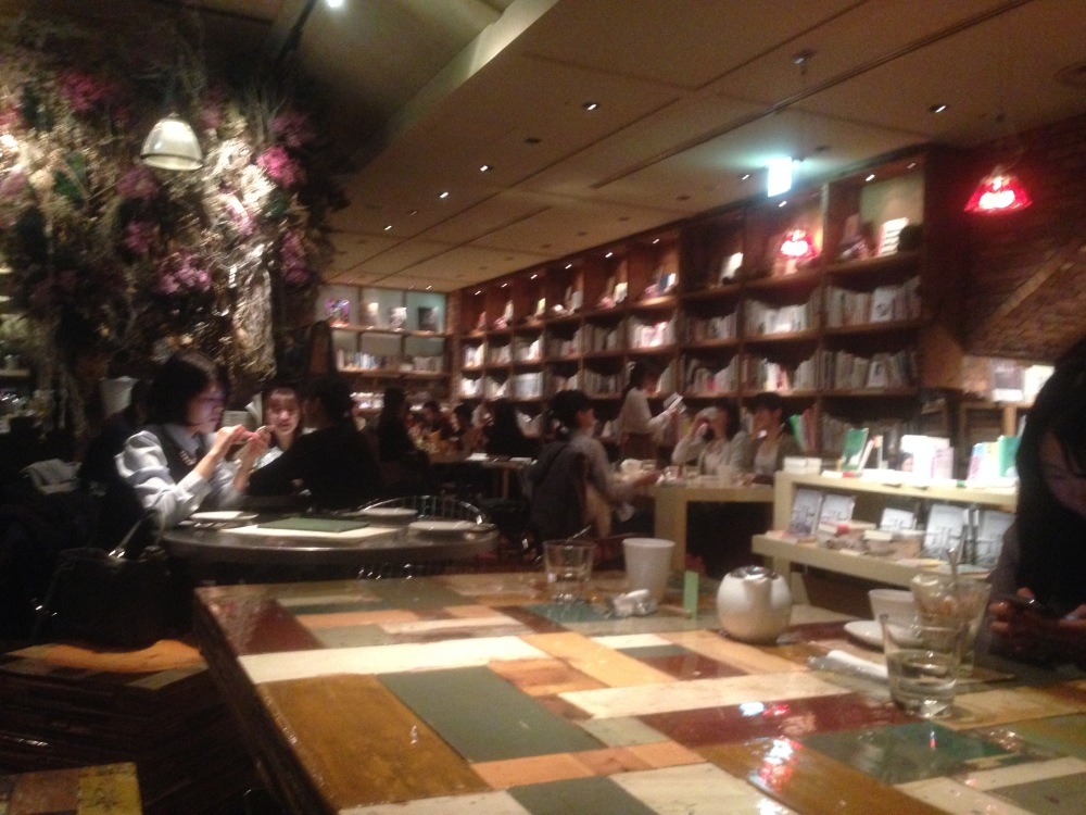 Book cases around dining room at Brooklyn Parlor Cafe in Tokyo.JPG