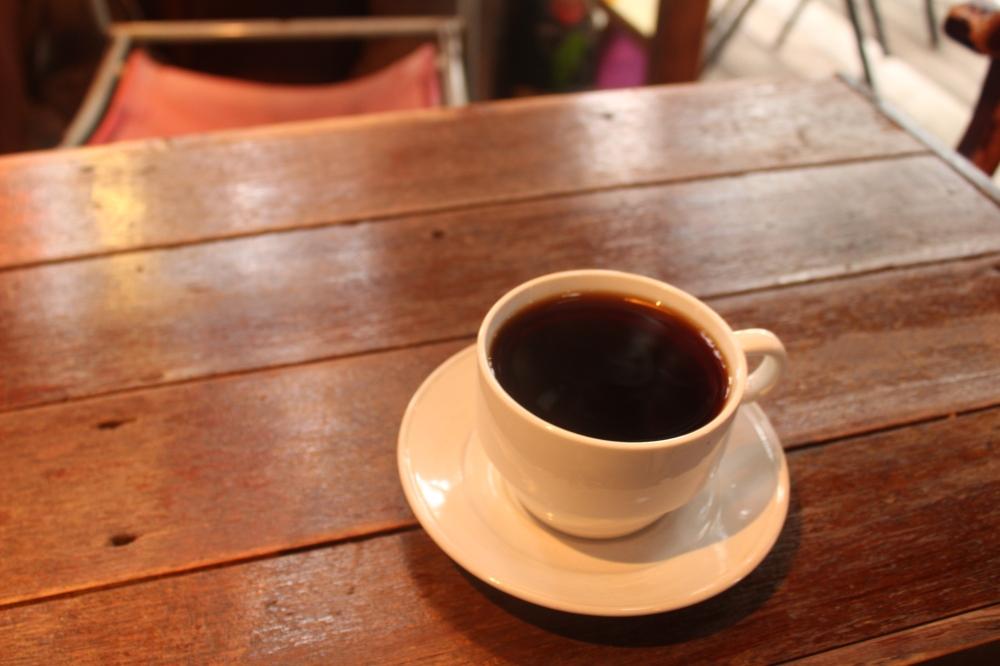 Nanjya Monjya treehouse black coffee wooden tABLE.JPG